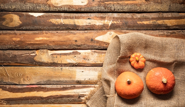 Flat lay pumpkin on canvas bag and wooden background Free Photo