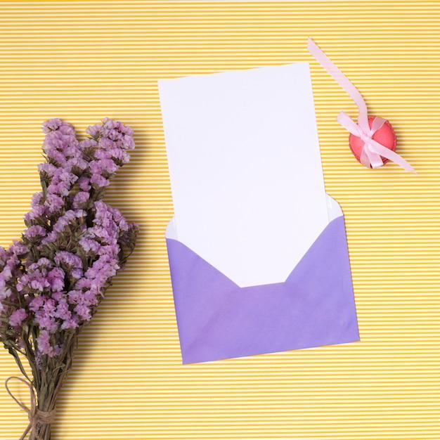 Flat lay purple birthday invitation mock-up Free Photo