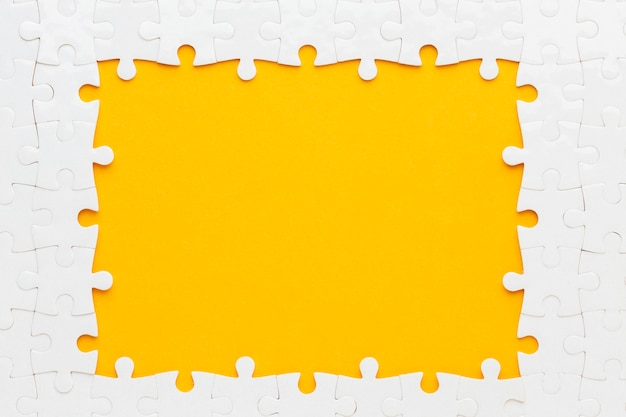 Flat lay of puzzle frame concept Free Photo