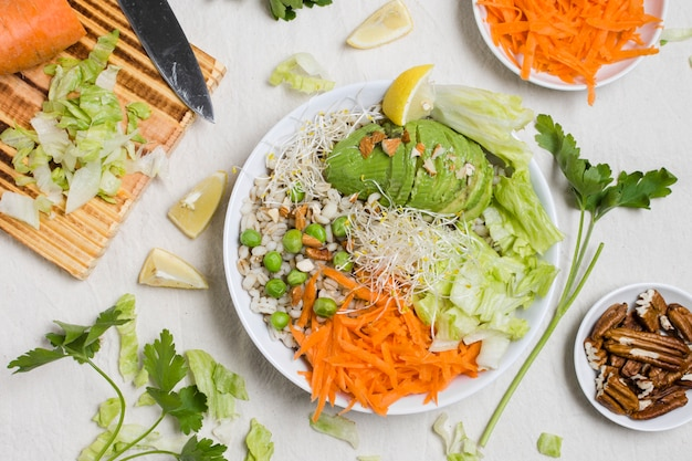 Flat lay of raw vegetables on plate Free Photo