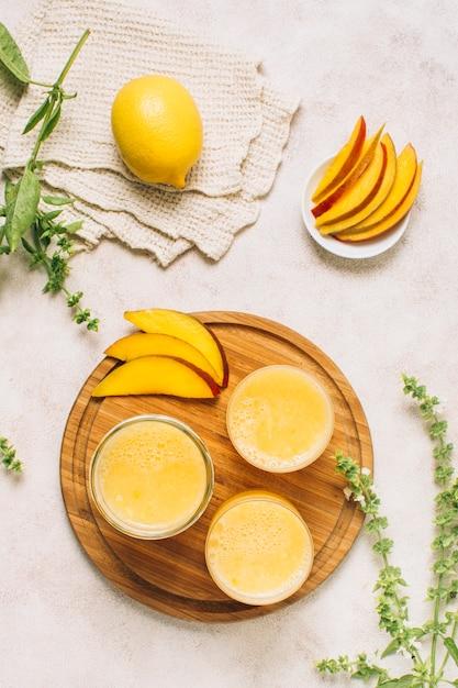Flat lay refreshing mango smoothies Free Photo