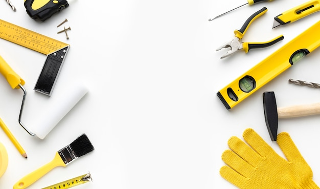 Flat lay repair tools frame with copy space Free Photo