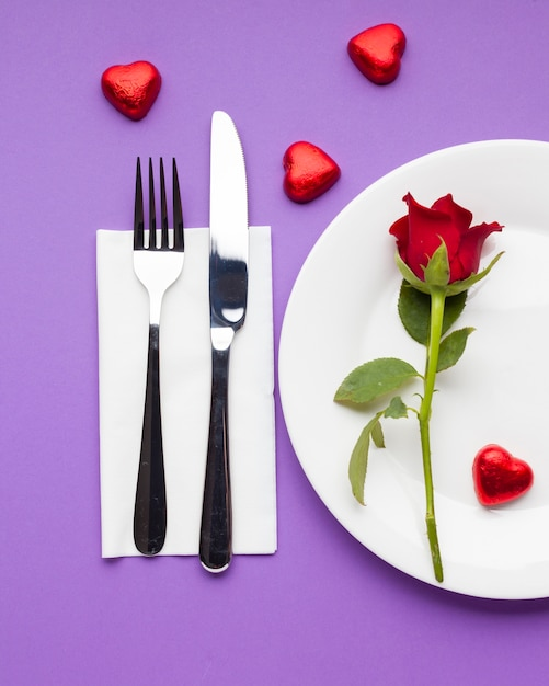 Flat lay romantic table setting with red rose Free Photo