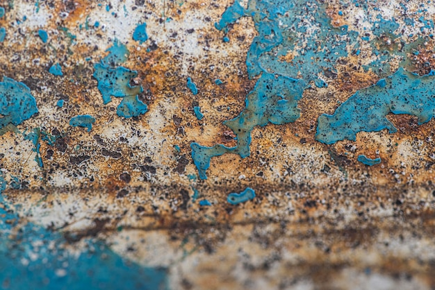Flat lay of rusty metal surface with paint peel Free Photo