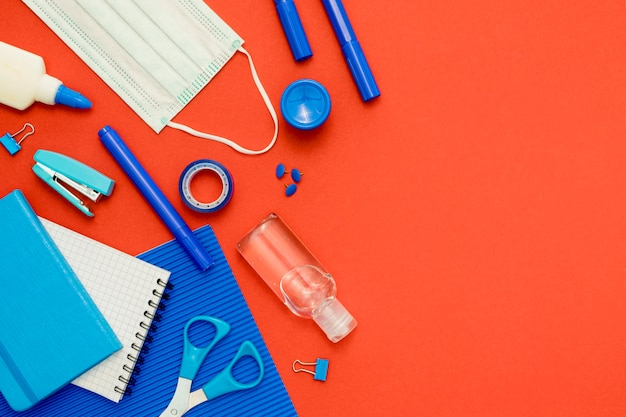 Flat lay school items on red background Free Photo