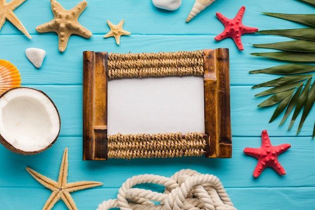 Flat lay seaside composition with picture frame Free Photo