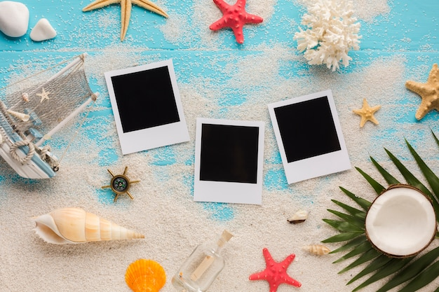 Flat lay seaside composition with polaroid pictures Free Photo