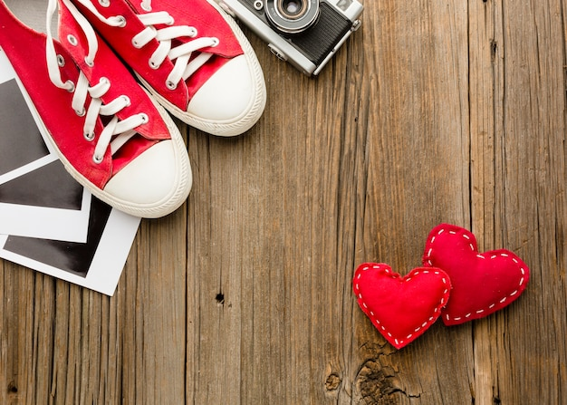 Flat lay of shoes and valentines day ornaments Free Photo