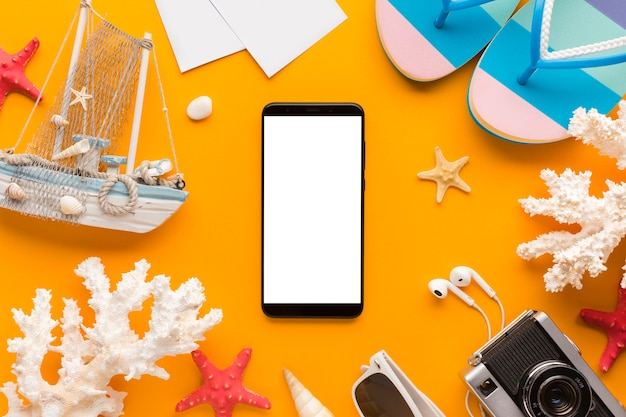 Flat lay smartphone with  summer vacation concept Free Photo