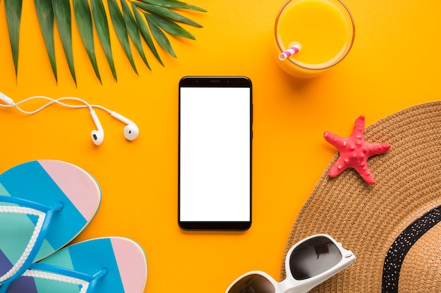Flat lay smartphone with  vacation concept Free Photo