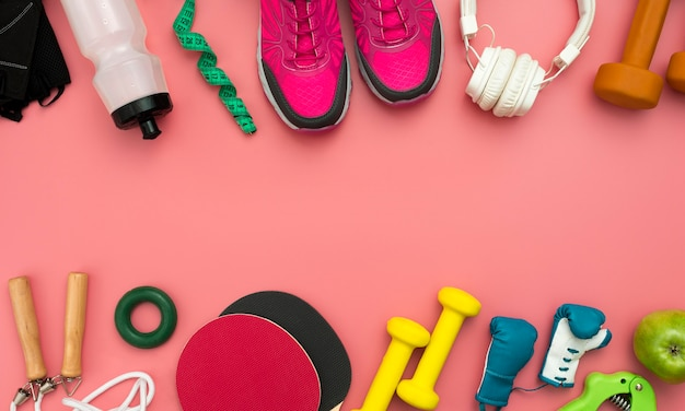 Flat lay of sneakers with gym essentials Free Photo