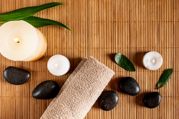 Flat lay spa concept with candles and stones Free Photo