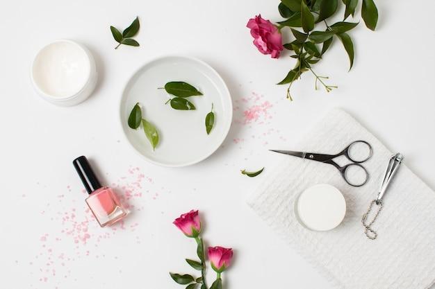 Flat lay spa concept with nail polish Free Photo