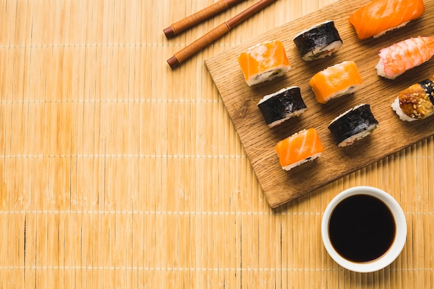 Flat lay sushi arrangement with copy space Free Photo