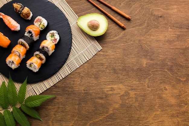 Flat lay sushi frame with copy space Free Photo
