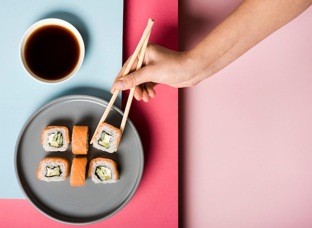 Flat lay sushi plate and soy sauce Free Photo