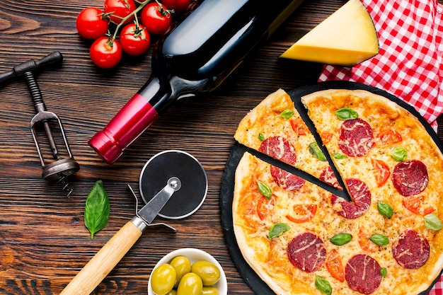 Flat lay tasty pizza composition Free Photo