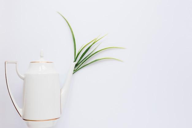 Flat lay of tea pot on white table Free Photo