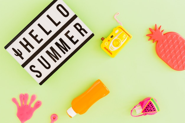 Flat lay of text and summer accessories Free Photo