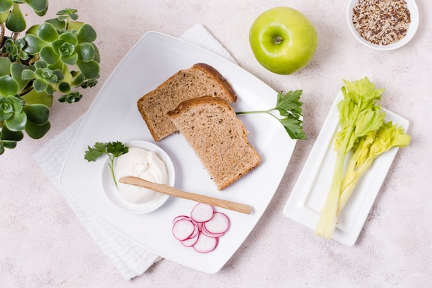 Flat lay of toast on plate with radish and apple Free Photo