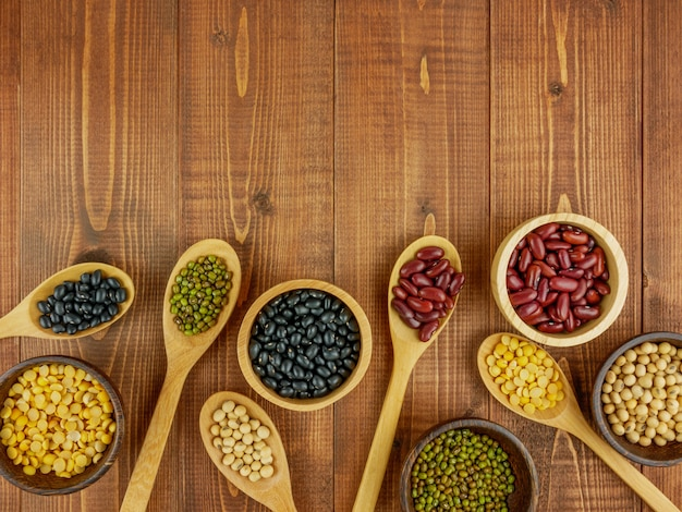 Flat lay, top view assorted beans on wooden table with copy space Premium Photo
