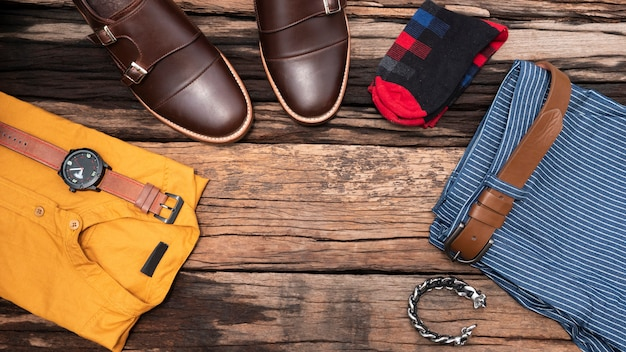 Flat lay, top view, men's accessories and essential travel items Premium Photo