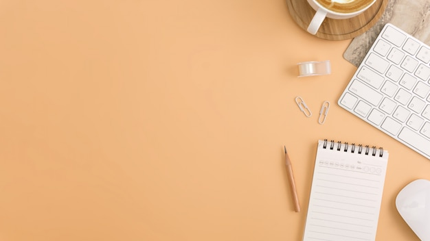 Flat lay, top view office workspace with blank note book, keyboard Premium Photo