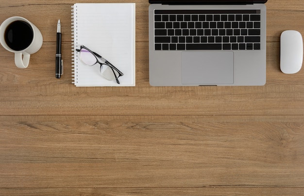 Flat lay, top view wooden office desk workspace Premium Photo