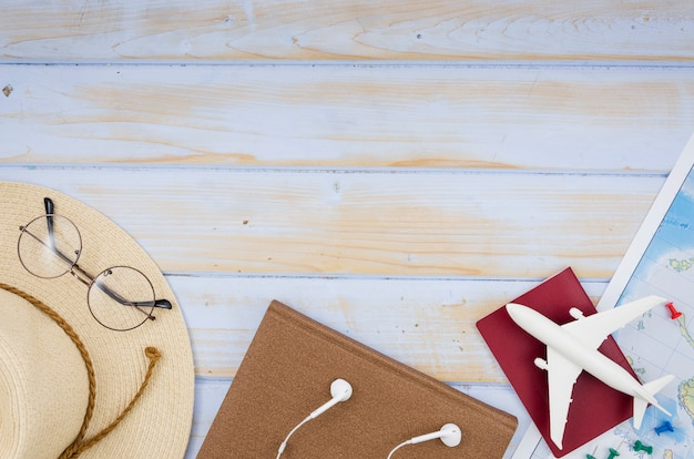 Flat lay of travel accessories with copy space Free Photo
