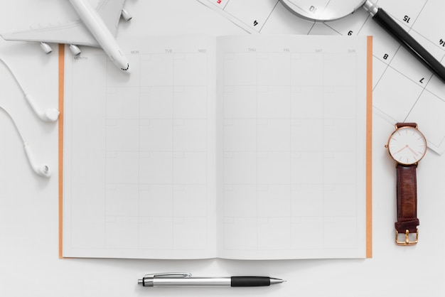 Flat lay of travel planning with blank space travel itinerary planner on white background Premium Photo