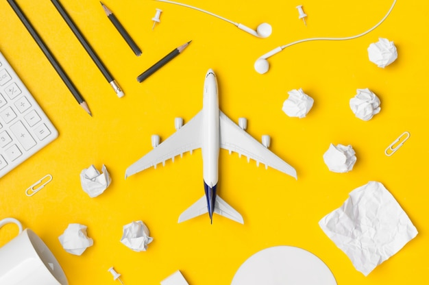 Flat lay of travel planning with blank space on yellow background Premium Photo