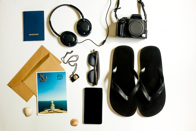 Flat lay traveler stuff on white Premium Photo
