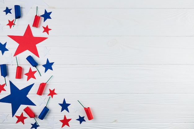 Flat lay of usa stars and firecrackers Free Photo