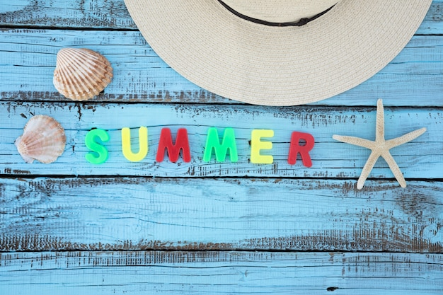 Flat lay vacation accessories with summer letters Free Photo