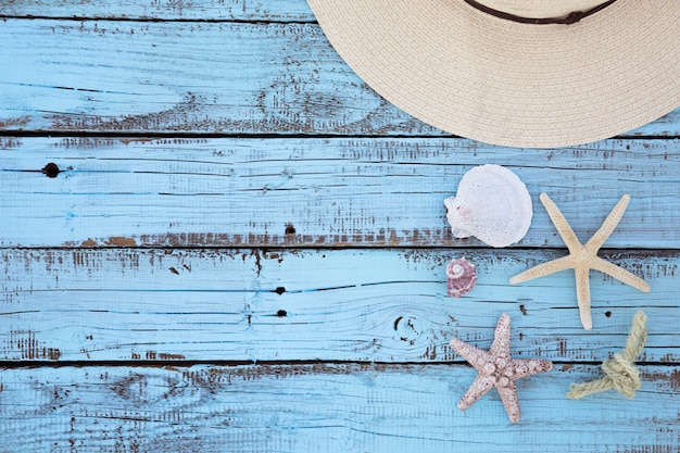Flat lay vacation accessories wooden board Free Photo