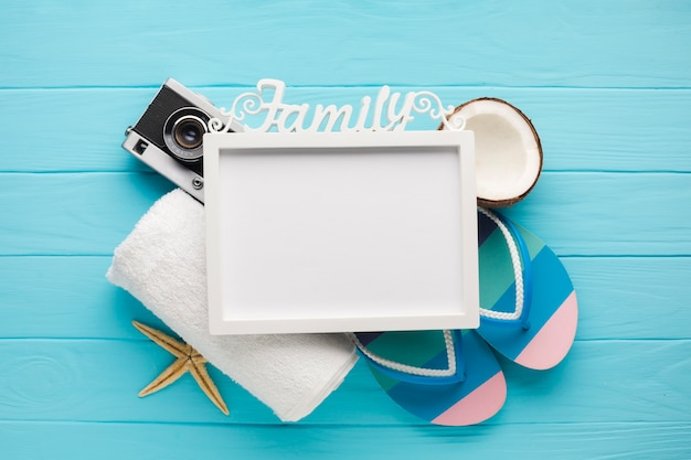 Flat lay vacation composition with photo frame Free Photo