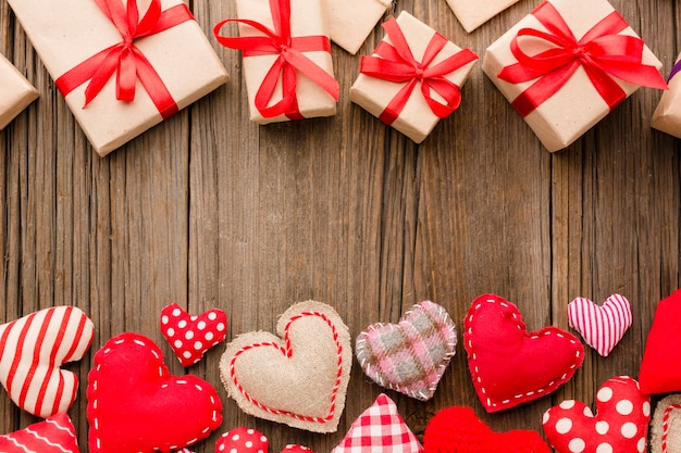 Flat lay of valentines day ornaments with presents Free Photo