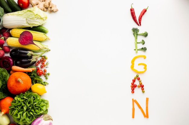 Flat lay vegan lettering made out of vegetables Free Photo