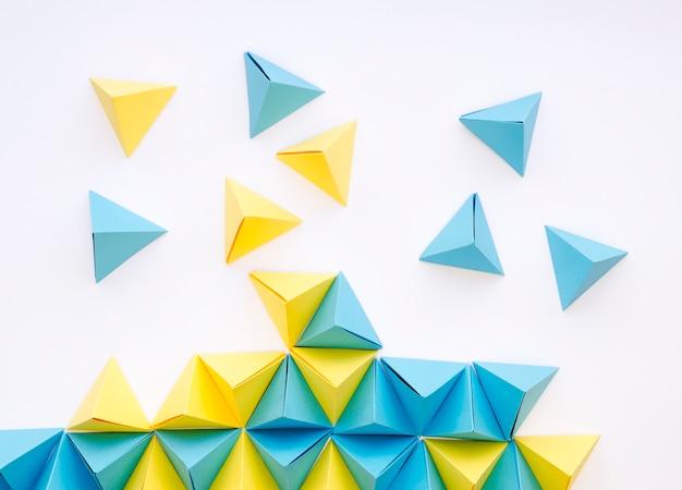 Flat lay of vibrant paper pyramids Free Photo