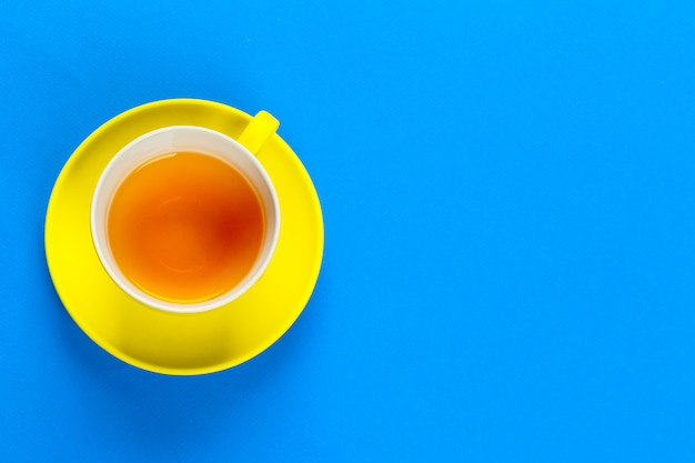 Flat lay view coffee or tea cup on color background Premium Photo