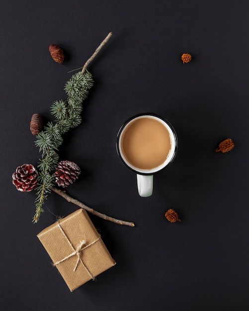 Flat lay warm beverage next to christmas decorations Free Photo