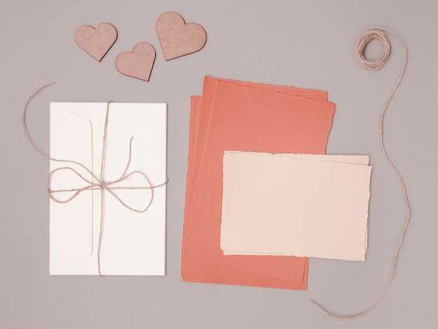 Flat lay wedding decoration with invitations and ornaments Free Photo
