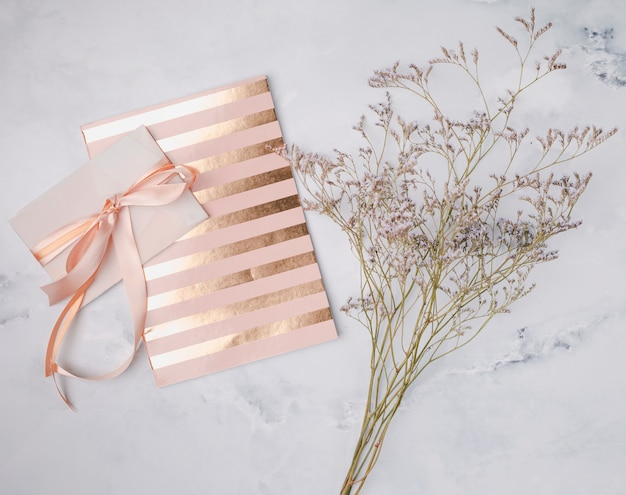 Flat lay wedding invitation with golden lines Free Photo