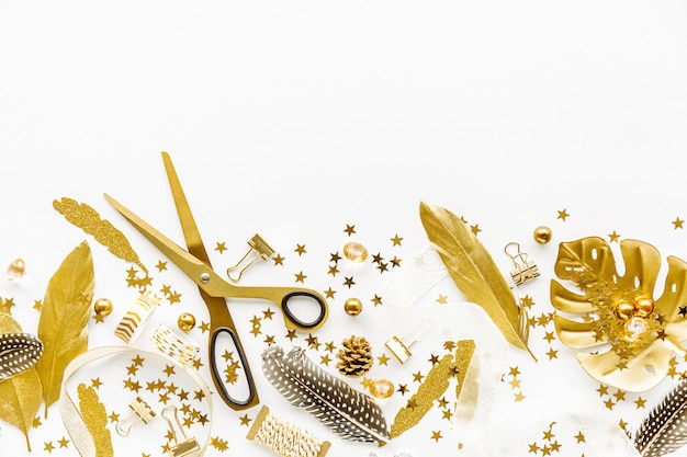 Flat lay on white background with golden deco Free Photo