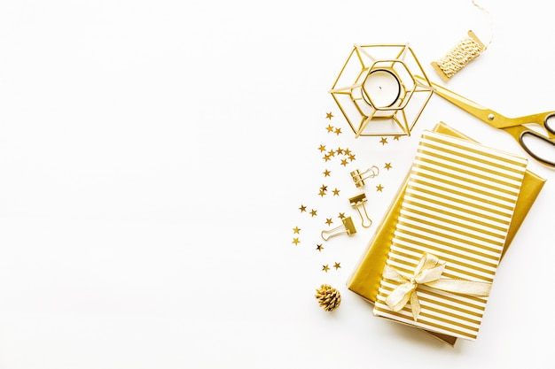 Flat lay on white background with golden deco Premium Photo