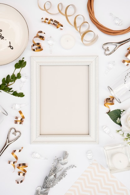 Flat lay of white wedding frame with decorations Free Photo