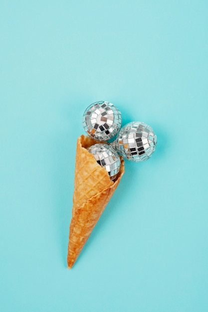 Flat lay with disco balls in the cone Premium Photo