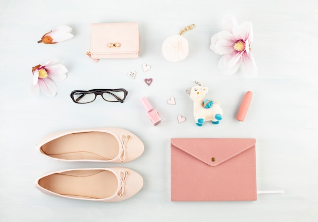 Flat lay with girls spring summer accessories in pink pastel tones. casual urban summer style Premium Photo