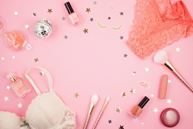 Flat lay with glamour girls accessories over pink background Premium Photo