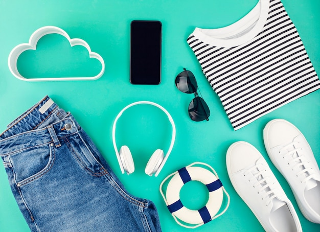 Flat lay with man's spring summer accessories over aquamarine background Premium Photo